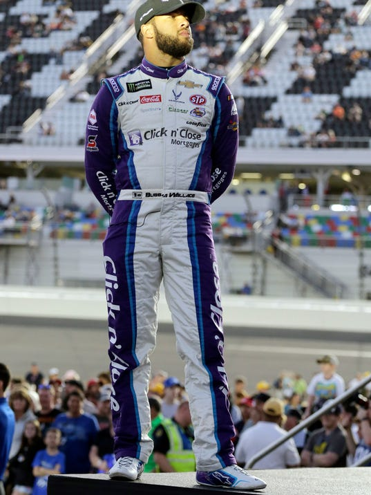 Darrell Wallace Jr. looks out from the stage during driver introductions before the first of two qualifying races for the NASCAR Daytona 500 auto race at Daytona International Speedway in Daytona Beach, Fla., Thursday, Feb. 15, 2018. (AP Photo/Terry Renna)