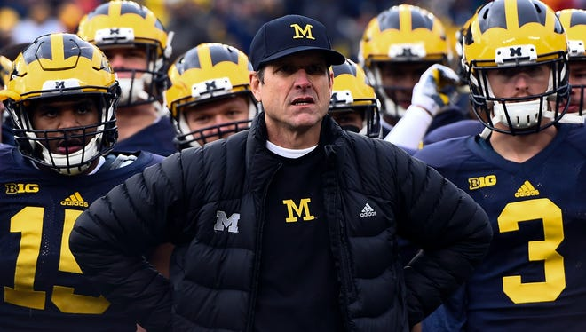 Jim Harbaugh and the Wolverines before their game last Nov. 28.