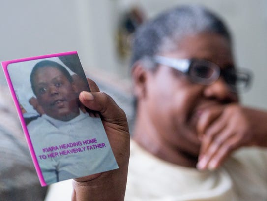 Rosa Bridges holds a photo of her recently deceased