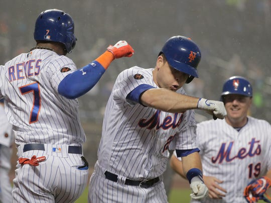 New York Mets' Devin Mesoraco (29) celebrates with Jose Reyes (7) after hitting a two-run home run against the Arizona Diamondbacks during the eighth inning of a baseball game, Saturday, May 19, 2018, in New York.