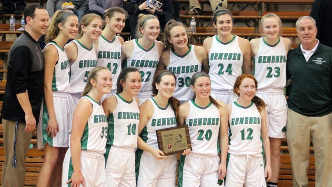 Members of the Geneseo High School girls basketball team pose after being awarded the trophy for winning the Martin Luther King Jr. Invitational Tournament title on Monday at the Kewanee National Guard Armory.