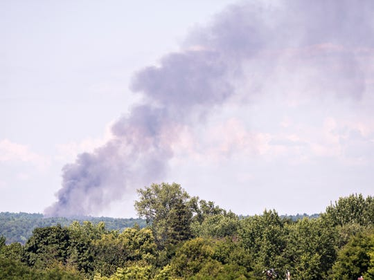 Smoke rises from a brush fire in Colchester on Tuesday, Aug. 2, 2016.