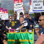 New TWU union leader Harry Lombardo leads a protest outside the Las Vegas headquarters of Allegiant Air in Las Vegas on Sept. 27, 2013.