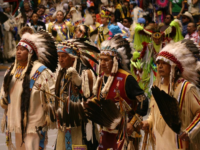 Elders lead more than 3,000 dancers in the Grand Entry at the annual Gathering of Nations.