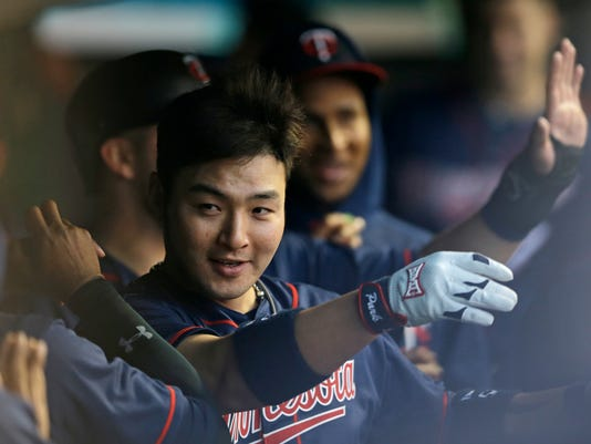Minnesota Twins' Byung Ho Park celebrates with teammates in the dugout after hitting a two-run home run off Cleveland Indians starting pitcher Josh Tomlin during the third inning of a baseball game Friday, May 13, 2016, in Cleveland. (AP Photo/Tony Dejak)
