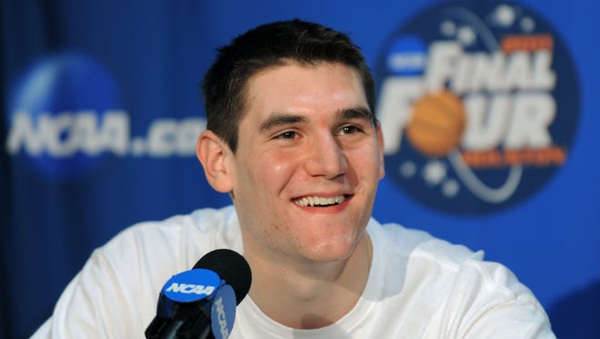 FILE--Butler Bulldogs player Andrew Smith is all smiles as he answers questions in the interview break-out rooms on Sunday, April 3, 2011. The players were interviewed one-on-one by the media about their preparation for the NCAA Men's Championship Game against the Connecticut Huskies at Reliant Stadium in Houston, Texas on Monday, April 4, 2011.