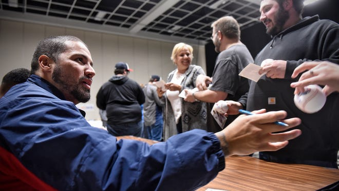 Minnesota Twins pitcher Hector Santiago signs autographs during the Twins Winter Caravan event Thursday, Jan. 19, at the River's Edge Convention Center in St. Cloud.