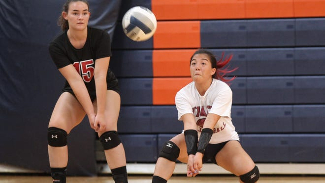 Nyack libero Rebecca Tan digs a serve during a five-team volleyball scrimmage at Horace Greeley High School in Chappaqua on Wednesday, August 23, 2017.