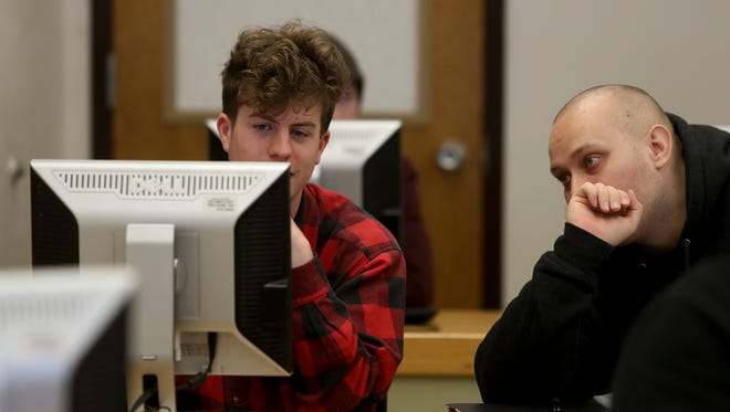 Shasta College students Sam Alexander, left, and Andrew Poston, work during an Introduction to Computer Science class Wednesday at the college in Redding.