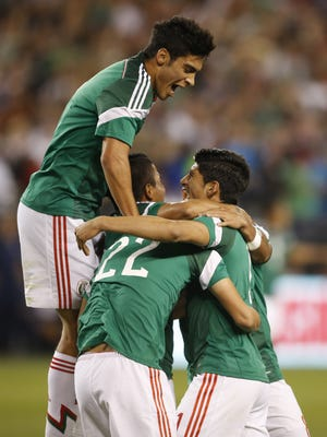 Mexico celebrates a goal against USA to tie the score 2-2 during the second half at University of Phoenix Stadium in Glendale, Ariz. April 2, 2014.