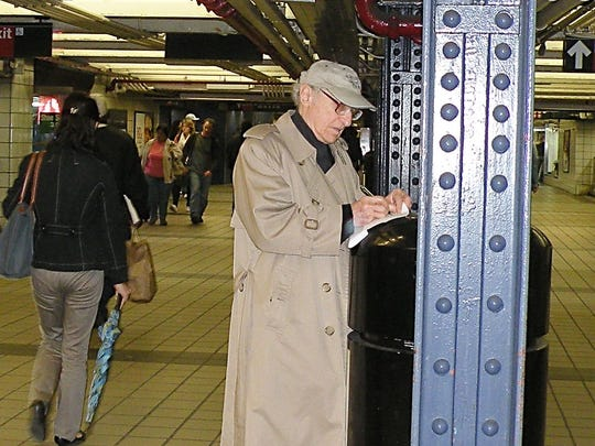 Sheldon Harnick in the subway jotting down a lyric
