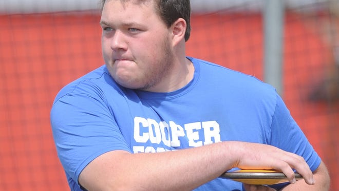 Cooper sophomore McCord Whitaker gets ready to throw the discus during practice Tuesday at Cooper High School. He earned a wild card spot in the event at the 5A state track and field meet, which begins Friday in Austin.