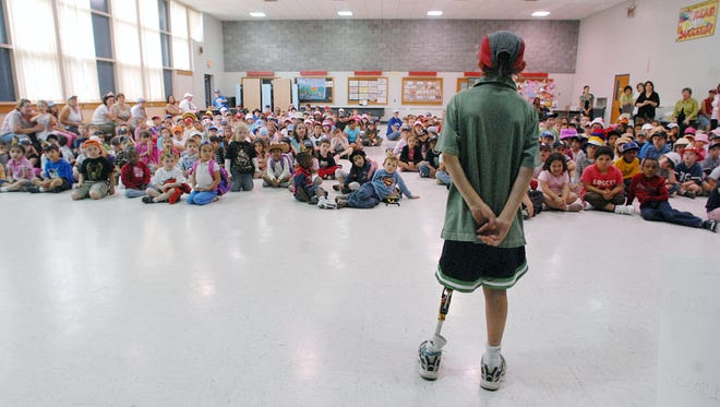 Liam Ollive, a fourth grader at Glenham Elementary School, thanks his classmates for raising $1700 to help fight cancer on Friday, June 6, 2008.