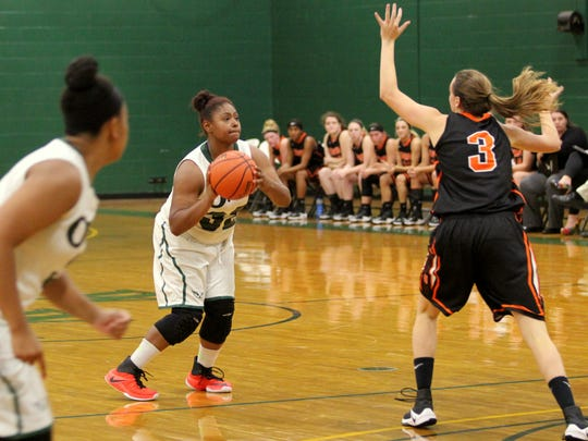 Sophomore Jada McCrimmon spots up for a 3-pointer against