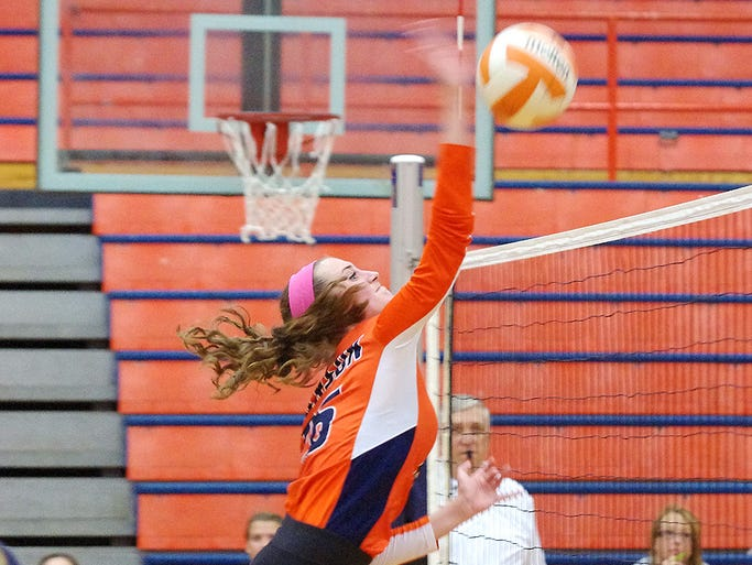 Dickson Co. senior Amber Jennings goes up for another kill shot against Independence. The Lady Cougars outlasted Independence for the 11-3A district win, 3-2.