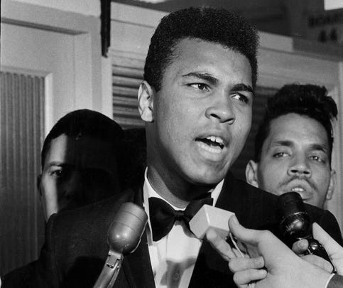 Muhammad Ali at the draft board office in Louisvile, March 17, 1966. (By Robert Steinau, The Courier-Journal)