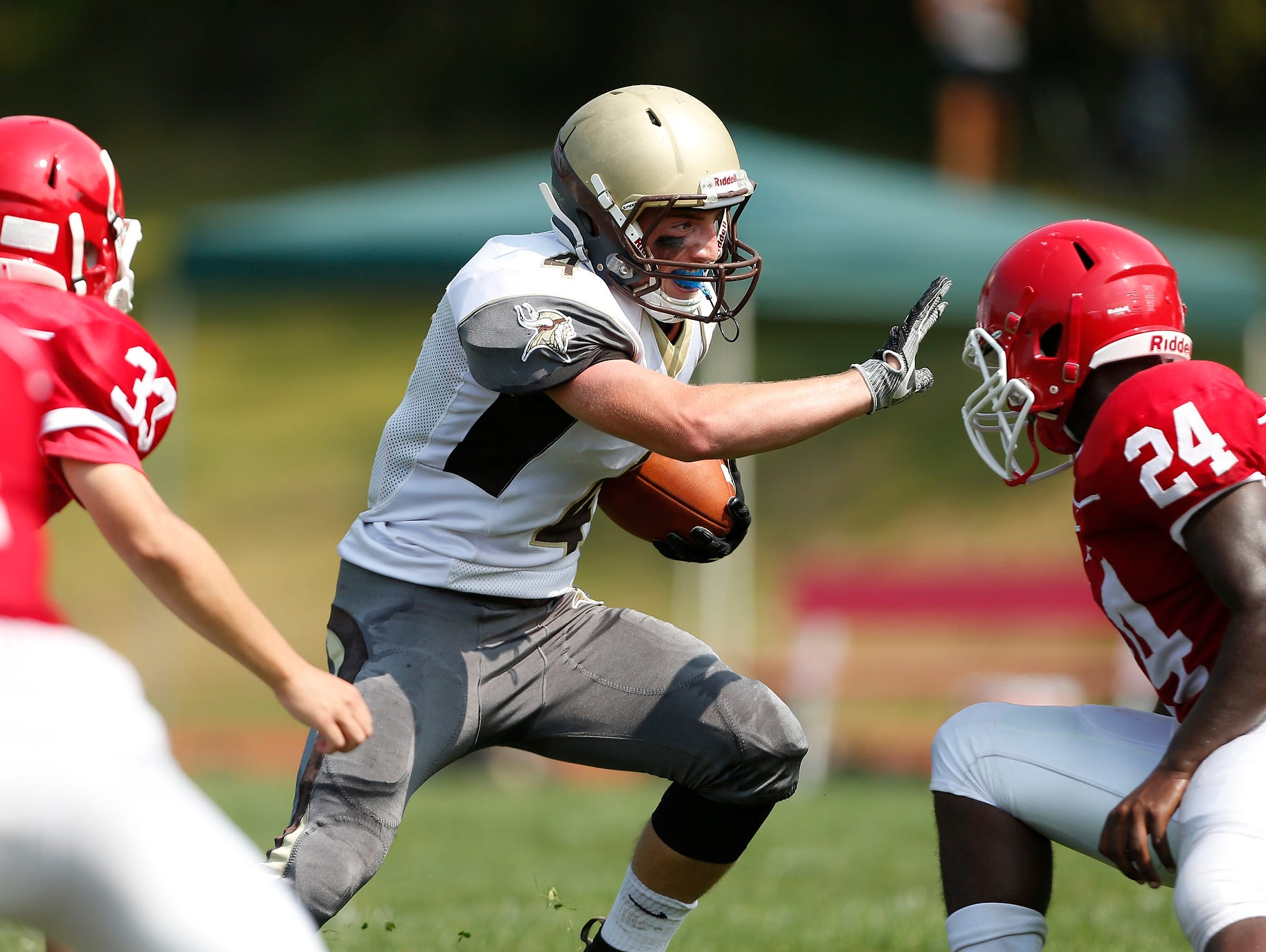 Clarkstown South's Kyle Samuels (4) looks for a hole during football action against North Rockland at North Rockland High School in Thiells on Saturday, September 10, 2016. The game second half is postponed due to heat. Clarkstown South is up at the half, 17-0.
