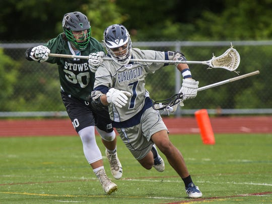 Burlington's Sevin Gulfield, right, is pressured by Stowe's Hunter Carpenter during the Division II state high school boys lacrosse championship in Burlington on Thursday.