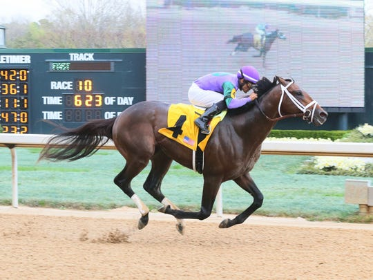Magnum Moon winning the March 17 Rebel Stakes at Oaklawn Park, ridden by jockey Luis Saez.