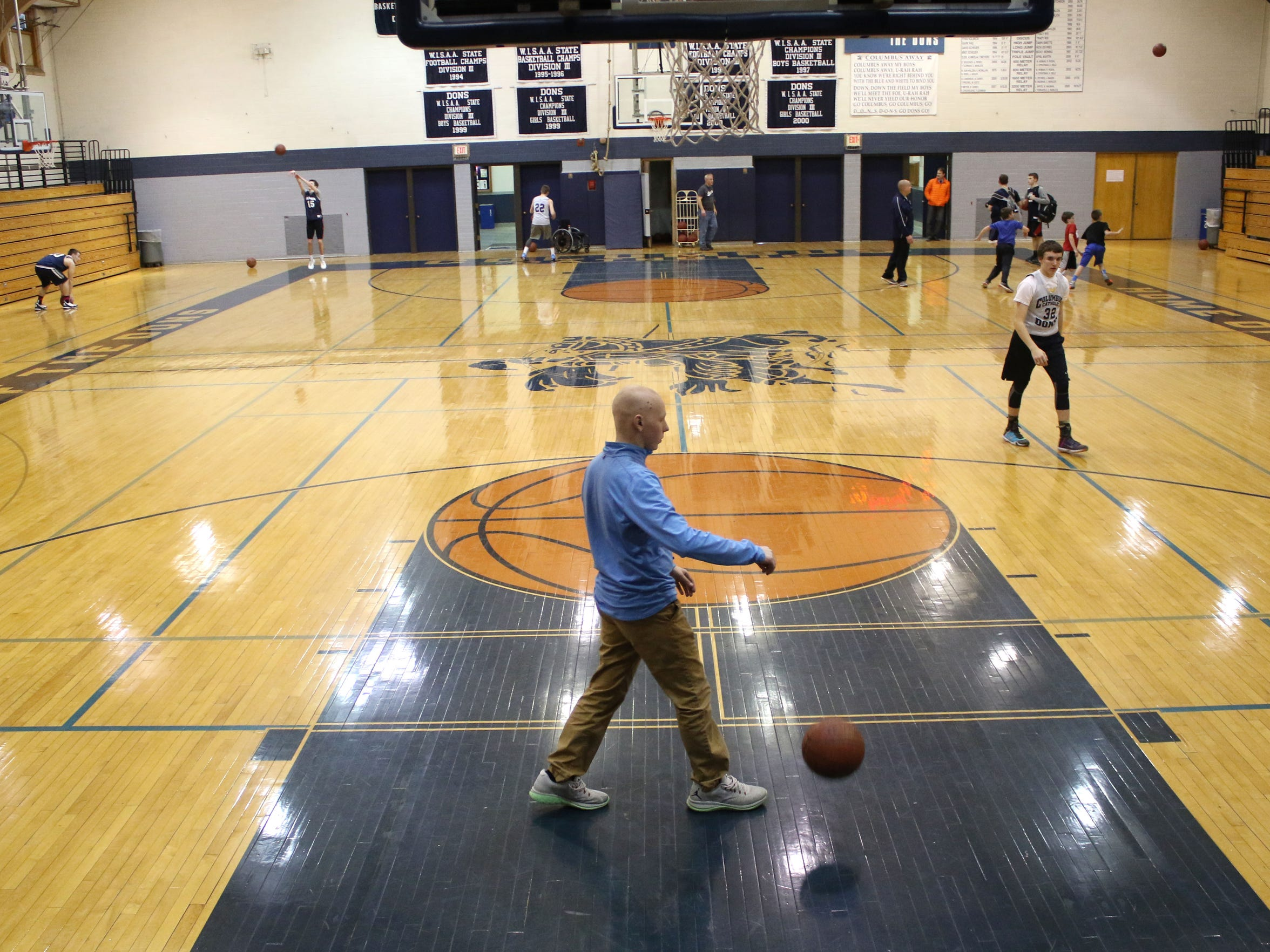 """Dieringer bounces a basketball at the conclusion of practice March 2, 2016.  He received his """"no evidence of disease""""  for his cancer less than a week, but Dieringer plans to build back up to being the three-sport athlete he was 11 months ago."""