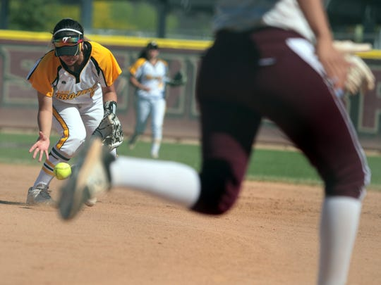 Yucca Valley's Alyssa Lynch tries to get a grip of the Rancho Mirage's Giselle Maldonado's base hit to load the bases on Thursday, April 26, 2018 in Rancho Mirage. The Rattlers lost the game 5 to 9.