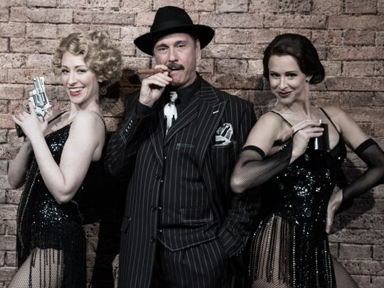 """Kevin Pariseau, who plays lawyer Billy Flynn, stands between Kaitlyn Davidson (Roxie Hart) and Heather Parcells (Velma Kelley) in """"Chicago."""""""