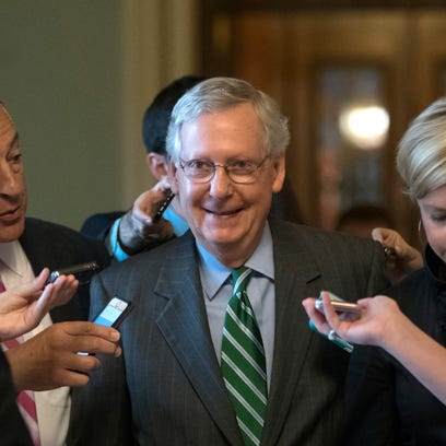 Senate Majority Leader Mitch McConnell smiles as he