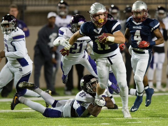 Park Crossing's Jackson Tate (11) is tackled by Blount's Kortlynd Williams (27) during the AHSAA State quarterfinal playoff football game between Park Crossing and Blount on Friday, Nov. 18, 2016, at the Cramton Bowl in Montgomery, Ala.