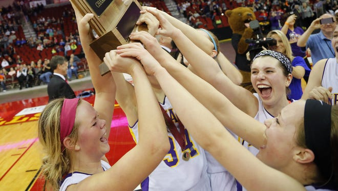 The Nevada girls celebrate winning the 3A state championship last March.