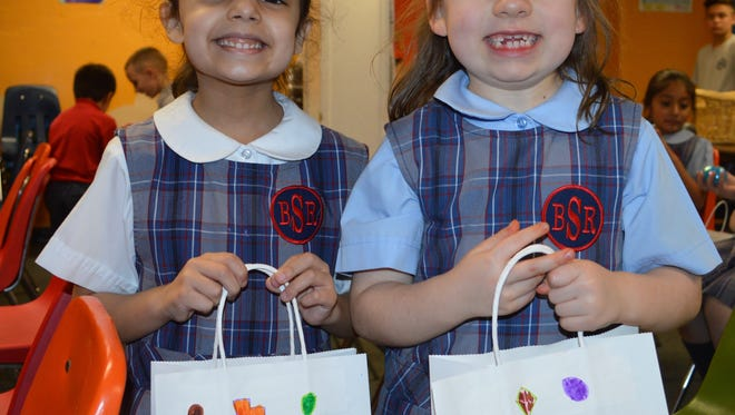 Analia Andeliz-Bello (left) and Sydney Sheldon, first graders at Bishop Schad Regional School, recently enjoyed participating in an Easter Egg Hunt at school in Vineland.