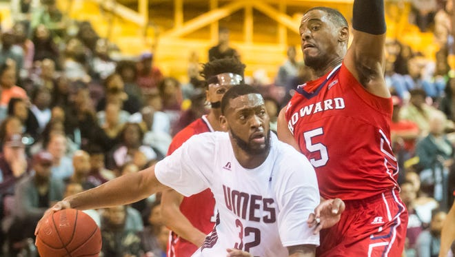 UMES center Dominique Elliot (32) drives into the paint while guarded by Howard center Marcel Boyd (5) on Monday, Feb 1 at the William P. Hytche Athletic Center in Princess Anne.