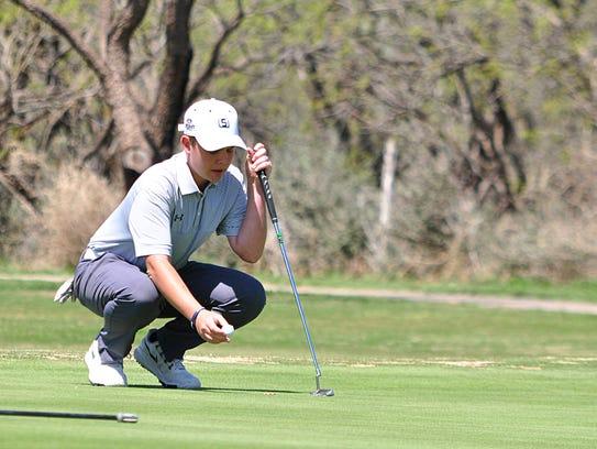 Abilene High freshman Jacob Wright sets up a putt on