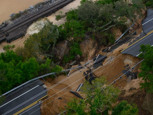 Scenic Highway collapsed into the bluffs and bay on the 3800 block of the road.