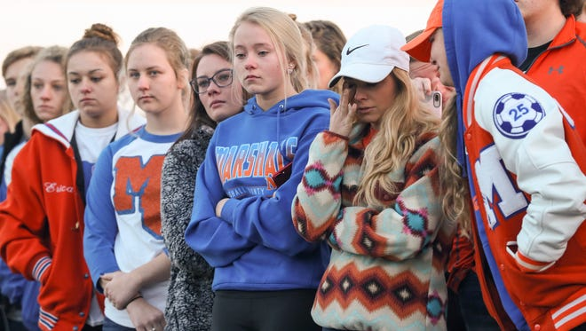 Marshall County High School student Keatyn Gamble wipes away tears during a prayer circle at Paducah Tilghman High School on Wednesday morning.  Students held the prayer circle for Marshall County High School after a shooting left two students dead and 18 more injured.