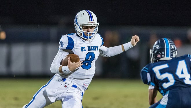 St. Mary quarterback Aaron Howell (8) eludes Ethan Danos (54) of Ascension in an LHSAA semifinal matchup in the 2015 Division IV playoffs. The Tigers were the district runners-up to Logansport last season.