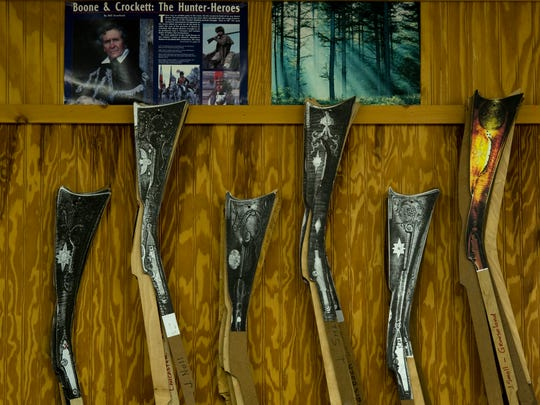 Patterns of different styles of longrifles hang in Marvin J. Kemper's shop, Liberty Longrifles, for easy access. Some of his customers want exact replicas of the historic guns while others want a completely custom creation.