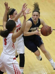 Appleton North's Callie Pohlman, right, drives to the