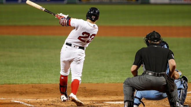 Boston's Michael Chavis hits an RBI single during the third inning of the second game of Friday's doubleheader against Toronto at Fenway Park.