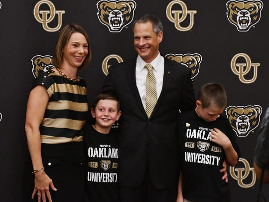 Steve Waterfield, new Oakland athletic director, poses with wife Jaime and sons Austin and Davis.