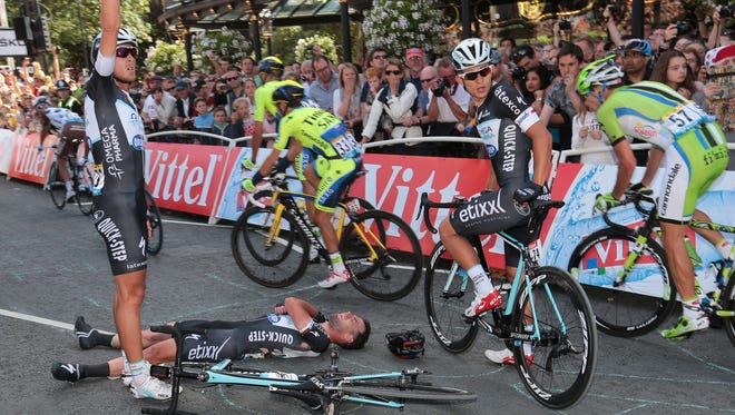 Britain's Mark Cavendish lies injured Saturday after a fall near the finish line at the end of the first stage of the 101st edition of the Tour de France.