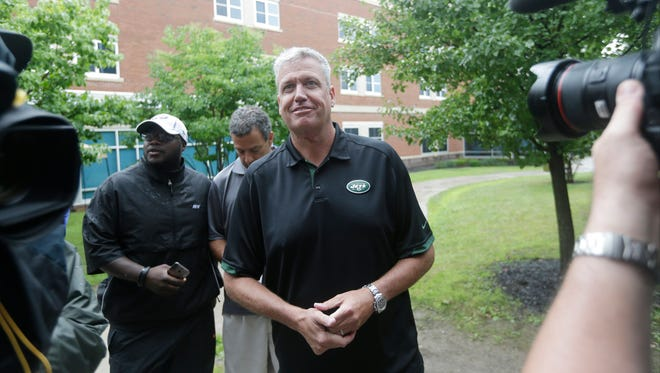 New York Jets coach Rex Ryan answers media questions as the team opened training camp July 23, 2014, in Cortland, N.Y.