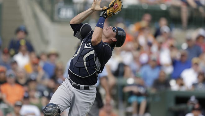 Yankees catcher Pete O'Brien catches a pop-up hit by the Orioles' Johnny Monell during the seventh inning of an exhibition game in Sarasota, Fla., on Saturday.