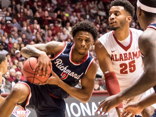 Richmond guard Khwan Fore (2) grabs a rebound against Alabama forward Braxton Key (25) during a first round NIT college basketball game in Tuscaloosa, Ala., Tuesday, March 14, 2017. (Vasha Hunt/AL.com via AP)