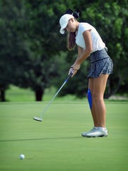 Wichita Christian's Savanah Snyder reacts as her putt just lips out during Monday's opening round of the Texas-Oklahoma Junior Golf Championship at the Wichita Falls Country Club.