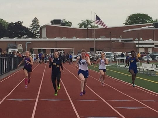 Mercersburg Academy's Finley Stewart leads the pack in the 100 at the Route 16 Invite in Greencastle on Monday. Stewart won three individual events and helped a Blue Storm relay team to victory as well.