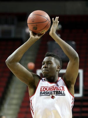 U of L's Chinanu Onuaku, #32, shoots during practice at the KeyArena in Seattle ahead of their matchup with UC Irvine in the second round of the NCAA tournament.March 19, 2015