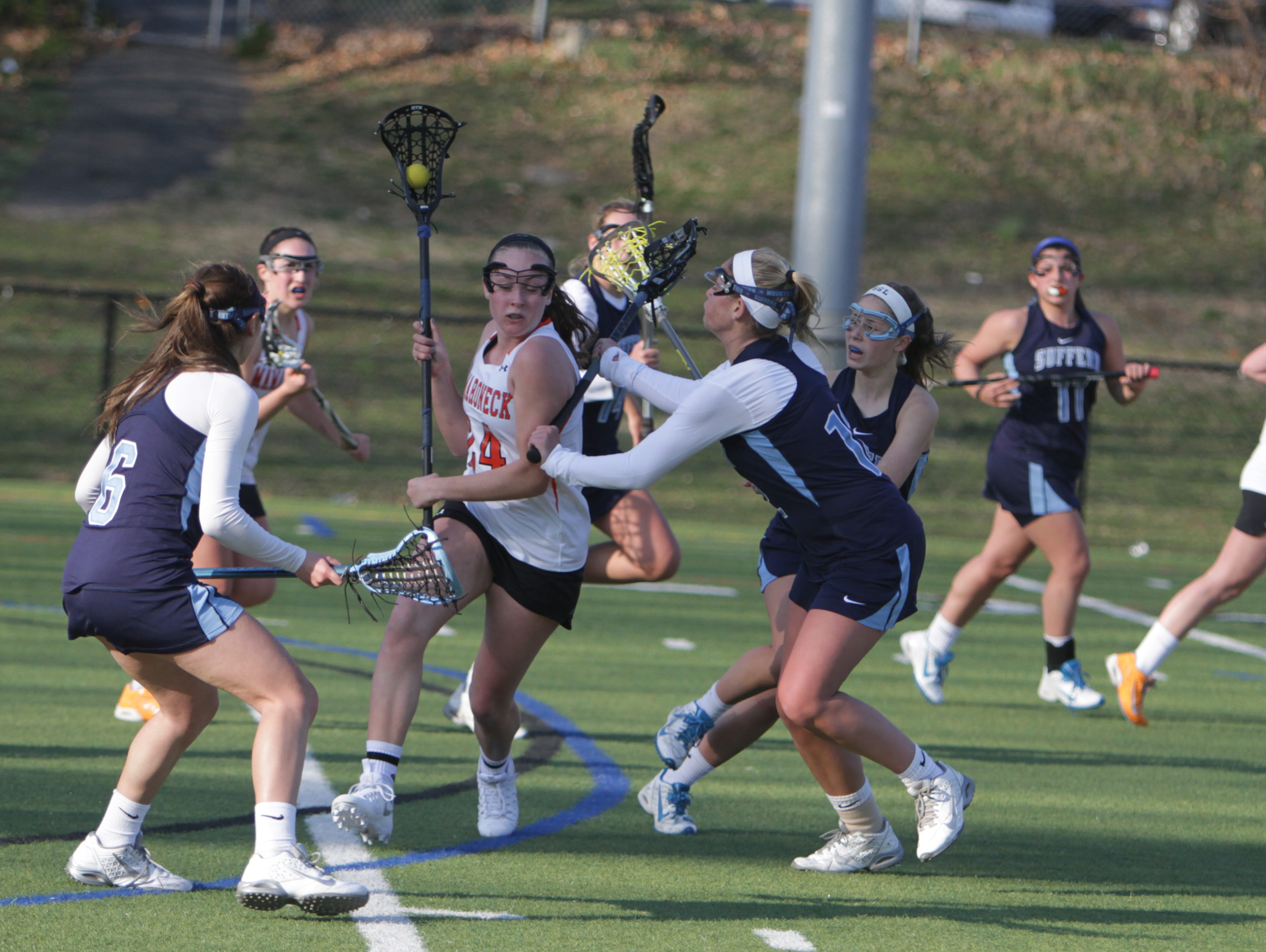 Game action during a Section 1 girls lacrosse game between Suffern and Mamaroneck at Mamaroneck High School on Tuesday, March 22nd, 2016. Suffern won 16-3.