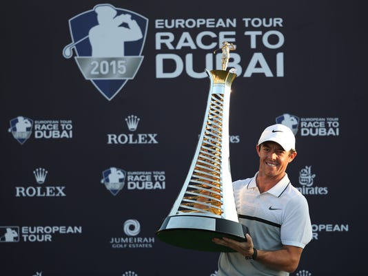 FILE - In this Sunday Nov. 22, 2015 file photo, Rory McIlroy of Northern Ireland poses with the Race to Dubai trophy after winning the final round of DP World Tour Championship golf tournament in Dubai, United Arab Emirates. Rory McIlroy has been voted as the European Tour's player of the year for 2015, winning the award for the third time in the last four seasons. (AP Photo/Kamran Jebreili, File)