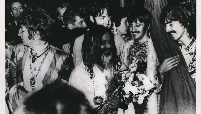 Britain's famed quartet, the Beatles, follow Maharishi Mahesh Yogi, the bearded founder of the International Meditation Society, as they arrive by train at Bangor, Wales, Aug. 26, 1967, to participate in a weekend of meditation. The Beatles (from left) are John Lennon, Paul McCartney, Ringo Starr and George Harrison.