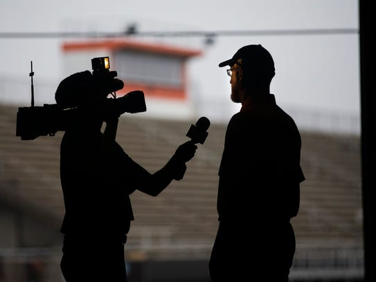 Refugio head coach Jason Herring is interviewed by a reporter during their media day Monday, Dec. 18, 2017, in Refugio. The football program was under the spotlight after the storm as HBO's Real Sports, Sports Illustrated, Bleacher Report, Christian Science Monitor and other publications came to town to tell the Bobcats' story.